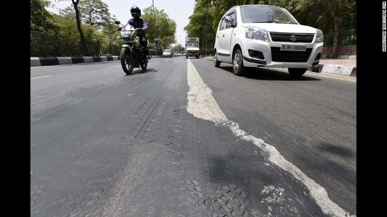 160525175455-india-melted-road-0519-restricted-exlarge-169