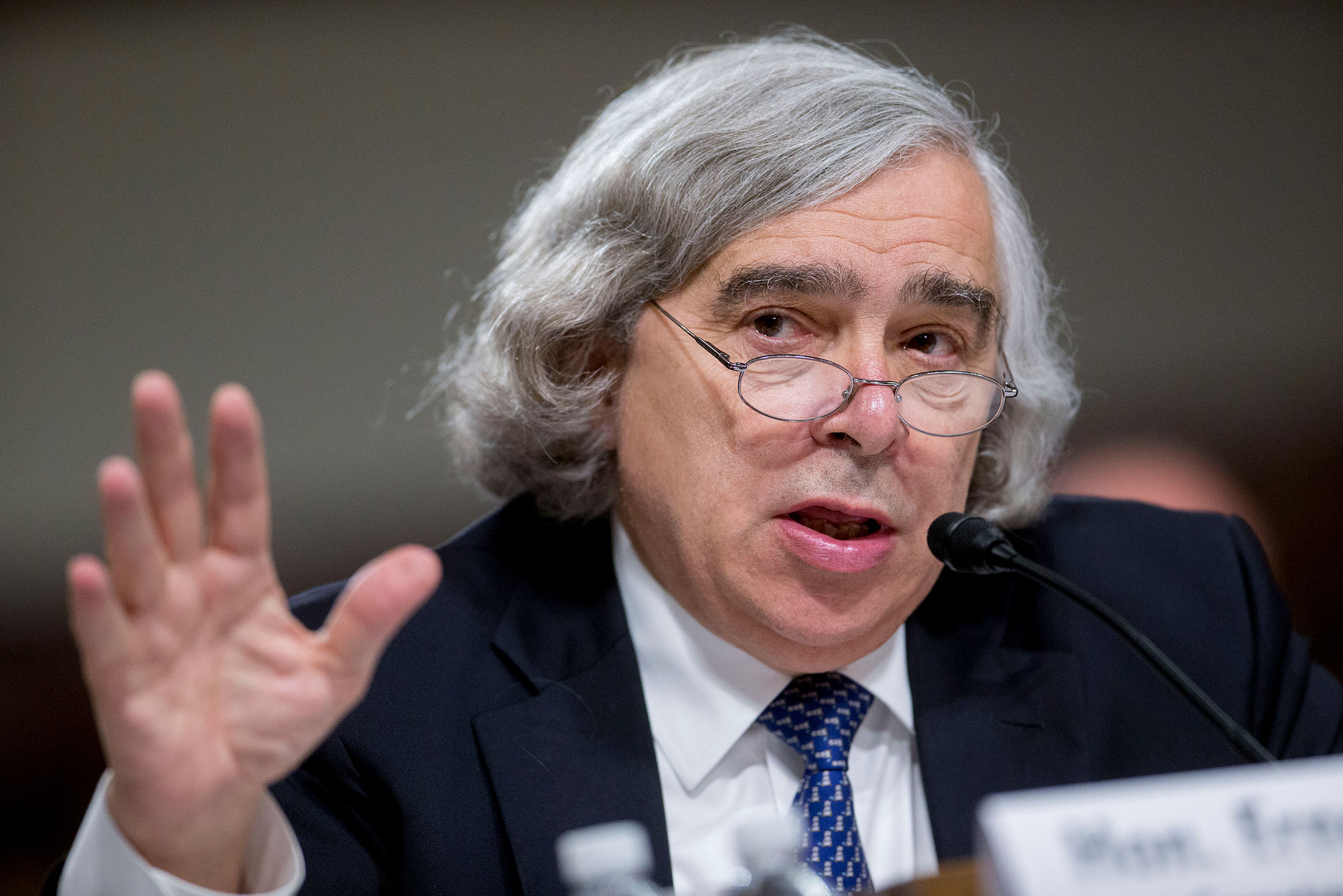 Ernest Moniz, U.S. secretary of energy, speaks during a Senate Foreign Relations Committee hearing in Washington, D.C., U.S., on Thursday, July 23, 2015. Senator Bob Corker, a key player in the congressional debate over the nuclear deal with Iran, told Secretary of State John Kerry that the Obama administration is engaging in hyperbole to sell it. Photographer: Andrew Harrer/Bloomberg *** Local Caption *** Ernest Moniz